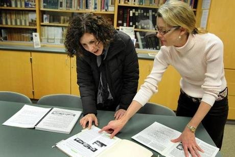 Norwell 1/19/2011- Historian Pamela Bower-Basso (cq) (left) and Chair of the Norwell Historical Commission, Wendy Bawabe (cq) (right), look over books and papers on the Sergeant Samuel Stetson house at #85 Stetson Shrine Lane in Norwell. The historical house is currently sitting on a privately owned parcel of land with only nine feet separating them. Photo by Debee Tlumacki for the Boston Globe (regional) Reporter: Meg Murphy